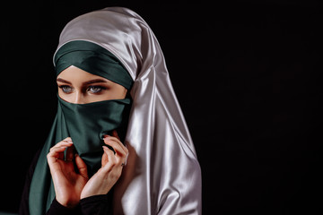 close up portrait of Mohammedan taking off her hijab. girl is going to show face to bridegroom. copyspace