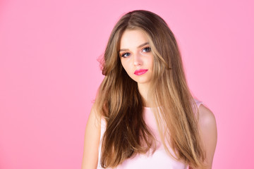 Makeup for sensual model with soft skin. Fashion look concept. girl with makeup and healthy hair. Beauty and hairdresser salon. Sexy woman with long hair on pink background, copy space