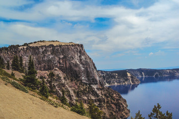 Cliff formation on the rim of Crater Lake in Oregon with a retro feel