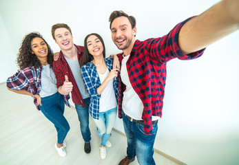 The four smiling people making a selfie
