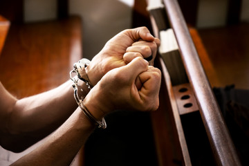 Male with a Handcuffed in the Church, Concept Piicture of the Sinner Who Need Jesus.