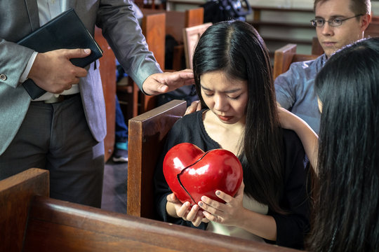Believers Praying For Young Sad Beautiful Girl with Her Broken Heart, Concept Picture of Love and Caring for Each Other.