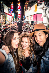 Friends taking selfie in Times Square