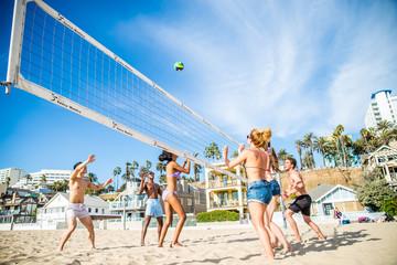 Friends play beach volley