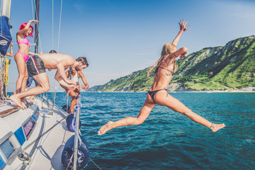 Friends on sailing boat