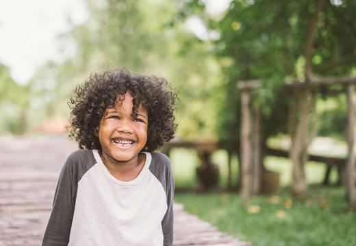 portrait of a cute african american little boy smiling.