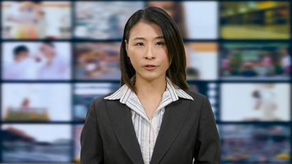 Asian anchorwoman in TV studio