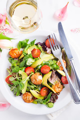 Fresh salad plate with shrimp, avocado, tomato and mixed greens