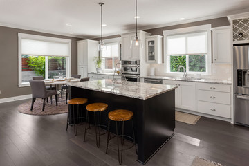 Kitchen in New Luxury Home with Island, Stainless Steel Refrigerator and Appliances, Range, Oven, Double Oven, and Pendant Lights