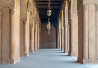 Corridor surrounding the courtyard of the Mosque of Ahmad Ibn Tulun framed by huge decorated arches, old Cairo, Egypt