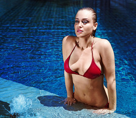 Portrait of a sexy woman in the swimming-pool