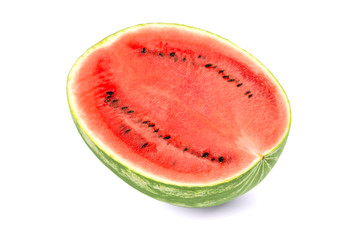 Sweet watermelon half, front view, on white background. Large ripe fruit of Citrullus lanatus with green striped skin, red pulp and black seeds. Edible, raw and organic. Food photo, closeup.