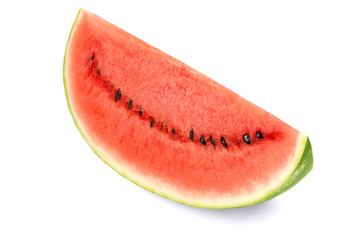 Sweet watermelon slice, front view, on white background. Large ripe fruit of Citrullus lanatus with green striped skin, red pulp and black seeds. Edible, raw and organic. Food photo, closeup.