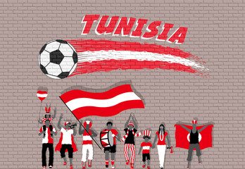 Tunisian football fans cheering with Tunisia flag colors in front of soccer ball graffiti