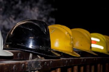 Firefighter helmets on old fire truck