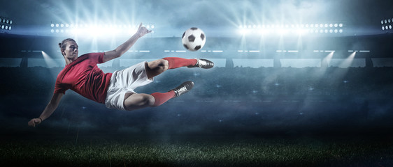 Fototapete - Soccer player in action on stadium background.