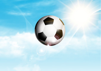 Soccer or football flying through a blue sunny sky