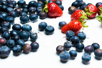isolated strawberries and blueberries on a white background