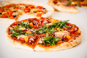 Pizzas on white background