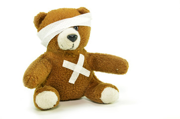 Injured teddy bear with bandages
