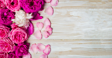 Pink roses arrangement on a wooden table