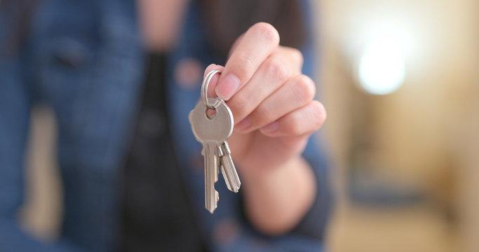 Woman holding key