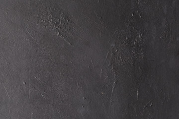 grey textured background. abstract stucco design. distressed scratched rough plaster backdrop. copy space concept