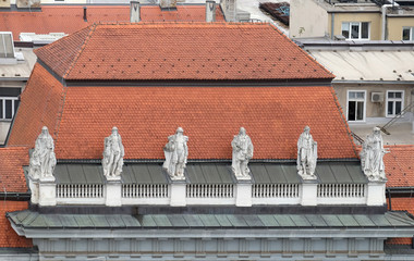 Statues on facade of the old city building in Zagreb, Croatia