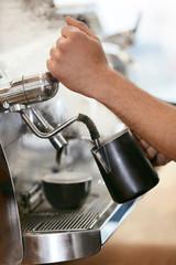 Barista Preparing Coffee On Coffee Machine