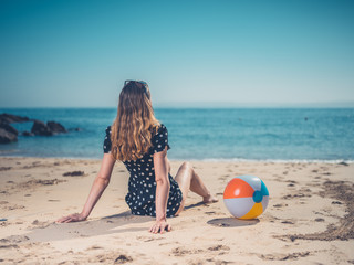 Young woman with beach ball