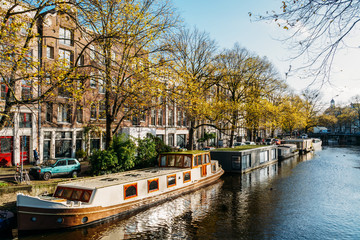 Beautiful Architecture Of Dutch Houses and Houseboats On Amsterdam Canal In Autumn