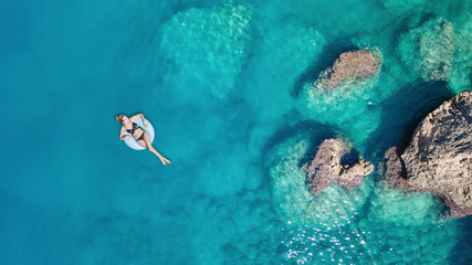 Aerial view at the girl on sea surface. Beautiful composition at the summer time Wall mural