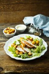 Grilled chicken Caesar salad with avocado