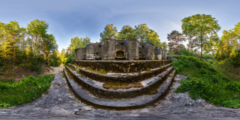 full seamless panorama 360 angle view battle position on abandoned military fortress of the First World War in forest in rays of setting sun in equirectangular spherical projection, skybox VR content