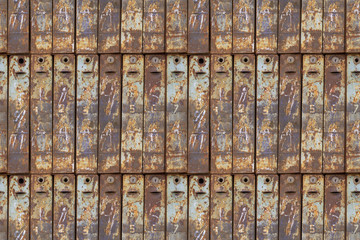 Seamless photo texture of mailbox stack with rust