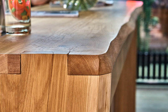 Wooden live edge table in solid oak. Solid oak counter top. Live edge counter top. Details furniture