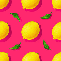 Yellow lemon fruits with green leaves isolated on pink background. Watercolor drawing seamless pattern for design