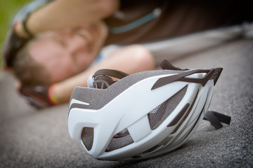 Bicycle accident, cyclist lying on the road