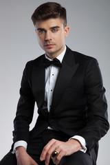 portrait of attractive young man in black tuxedo