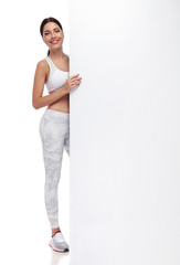 beautiful fit woman standing and holding white board