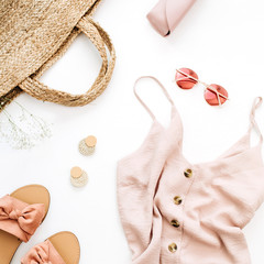 Pink feminine clothes and accessories on white background. Flat lay, top view. Summer fashion concept.
