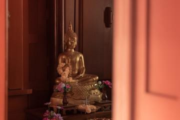 Beautiful of golden old Buddha statue in church.