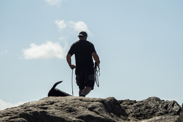 A man goes hiking with his dog
