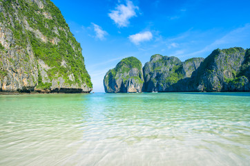 Quiet morning before the crowds arrive at Maya Bay, one of the iconic beaches of Southern Thailand which has just closed to tourists due to overcrowding and environmental concerns.
