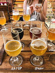 Tasting different types of craft beer and uploading photos to social networks from smartphone