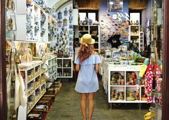 Blonde woman in souvenir shop in Lisbon, Portugal