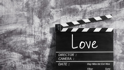 Love text title on movie clapper