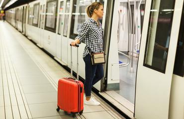 Girl entering subway coach