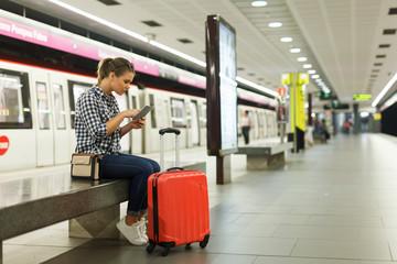 Woman sitting at metro station