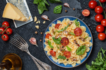 Italian pasta with sauce, cherry tomatoes, basil and parmesan cheese. Delicious pasta plate. Vegan pasta.